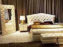 Фотография №1 интерьер спальни кровать с каретной стяжкой